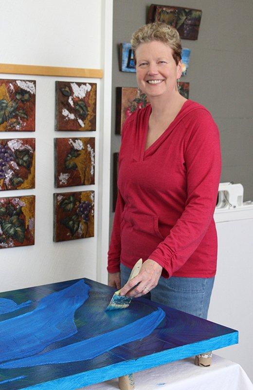 karen theusen working on painting in studio